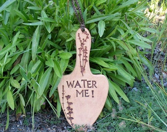 "Clay Garden Sign ""Water Me!"" - Trowel Shape with Impressed Plants - Garden Marker Decoration - Unique Hanging Sign - Yard Plant Stake"