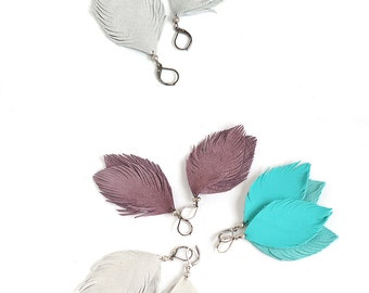 Leather or suede feather earrings in bright turquoise blue, light grey or smoky violet. One pair