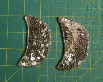 Silver half moon shaped beaded, sequined  applique pieces.