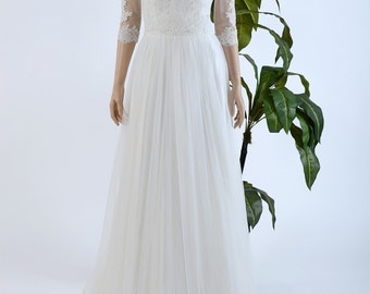 Lace wedding dress with off shoulder lace bolero on tulle