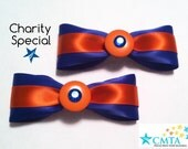 CMTA pair of blue and orange hair bows with buttons and rhinestones. 50% of sale goes to charity.