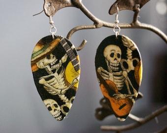 Sugar Skull holding guitars Earrings (Dia De Los Muertos)