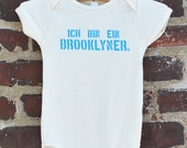 Ich Bin Ein Brooklyner - Organic Cotton Baby Onesie - Gender Neutral - Natural with Light Blue Text - Brooklyn Baby Gift