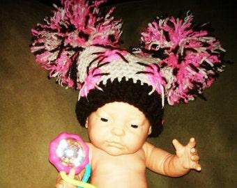 Crocheted Jester hat with BIG pom poms in espresso, cream, & pretty in pink
