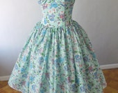 Beautiful 50s inspired cocktail dress made from adorable end of line limited edition red white and blue floral! DM