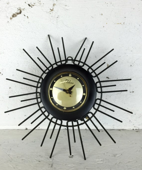 mid century modern starburst wall clock in black