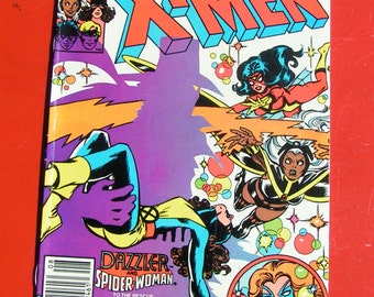 X- MEN 148   -  The Dazzler and Spider Woman  - Marvel Comics
