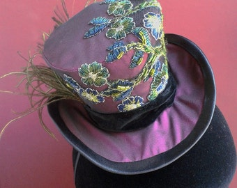 Purple mini top hat with hand-sewn embroidered tulle applique and peacock feather