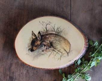 Fawn on wooden slab vintage art work