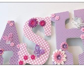 Baby Girl. Nursery. Butterfly Nursery Letters. Bedroom Wall Letters. Paisley. Stripes. Purple. Green. White. Flowers. Pink.