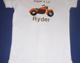 Appliqued onesie with orange motorcycle