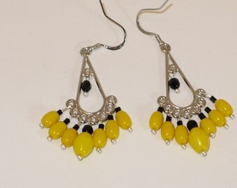 Black and yellow silver chandelier earrings.