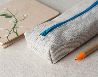 Natural linen pencil case with bright blue zip closure