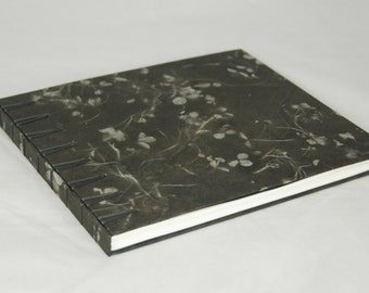 Unique Guestbook with handmade dark grey paper with blue flowers  in Secret Belgian Binding with grey satin tapes