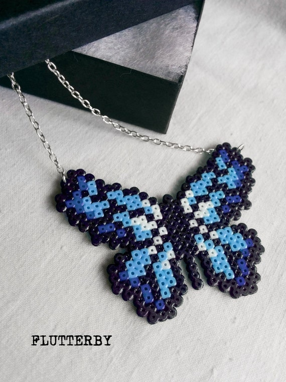 Flutterby necklace in shades of blue made of Hama Mini Perler Beads for those gamer girl butterfly lovers