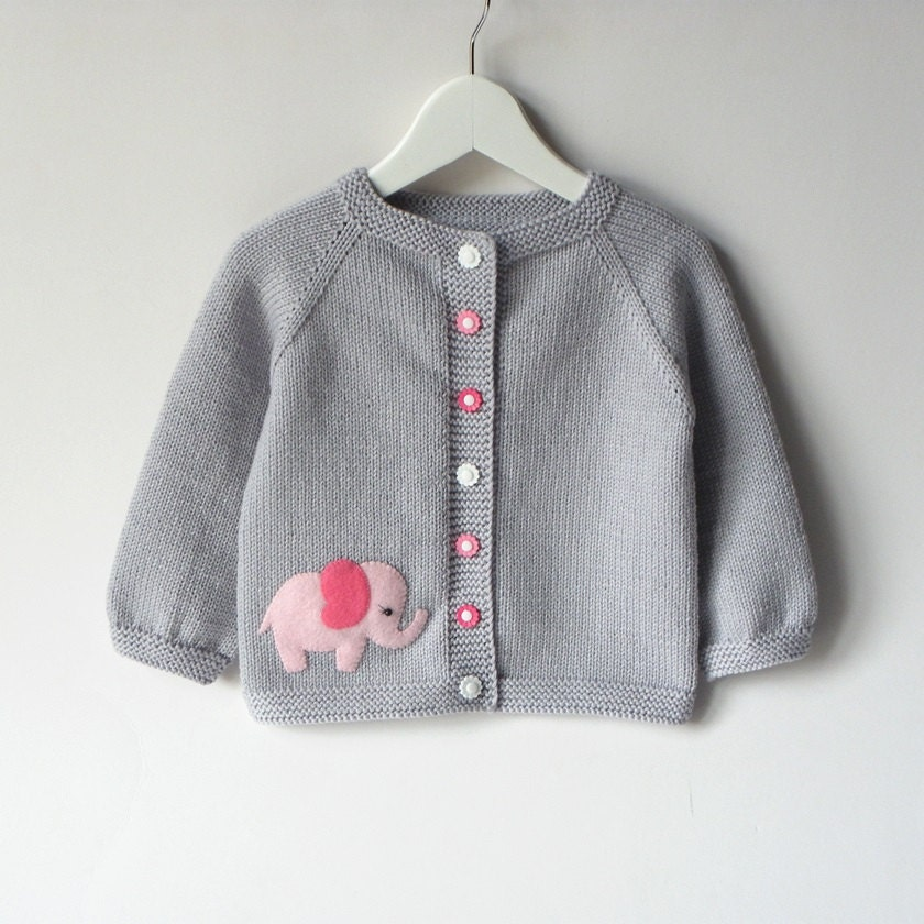 Sparkly buttons add a little flair to this girls' Carter's cardigan.