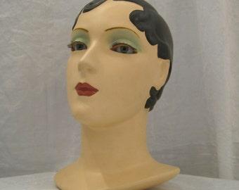 Brunette vintage mannequin head/hat stand
