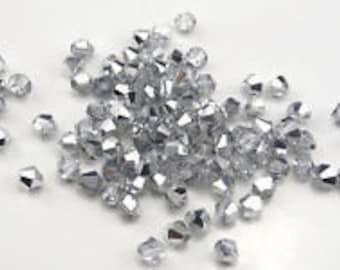 Swarovski 4 mm bicone beads shiny silver  AB 30 beads