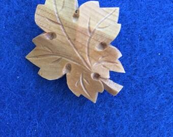 Maple leaf carved wooden pin - vintage