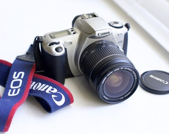 Canon EOS Rebel 2000 35mm Film SLR Camera with Canon EF 28 - 80 mm F/3.5-5.6 Zoom Lens, Cap, Strap - Pristine and Fully Functional