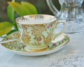 Delicate COLCLOUGH  Tea Cup And Saucer Light Green Multi Colored Flowers and Gilt, England