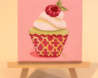 Original Lime Cupcake With Vanilla Icing and Raspberry on Top