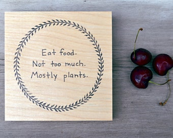 "modern rustic kitchen art: ""eat food,"" Pollan quote on birch wood panel"