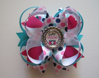 Say Cheese bottle cap bow