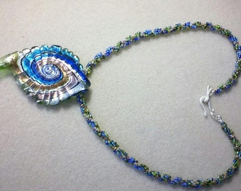 Lampwork glass focal with a beaded chain