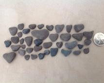 80 plus Black stone hearts Pebble art Heart shaped rocks Crafting stones Beach stone hearts Primitive hearts Heart art Beach wedding idea