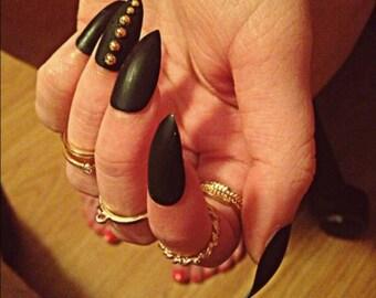 Matte black with gold stones nail set
