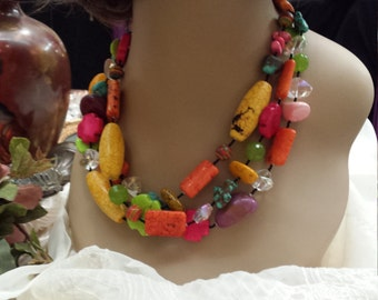 three strand beaded necklace with assorted  colors