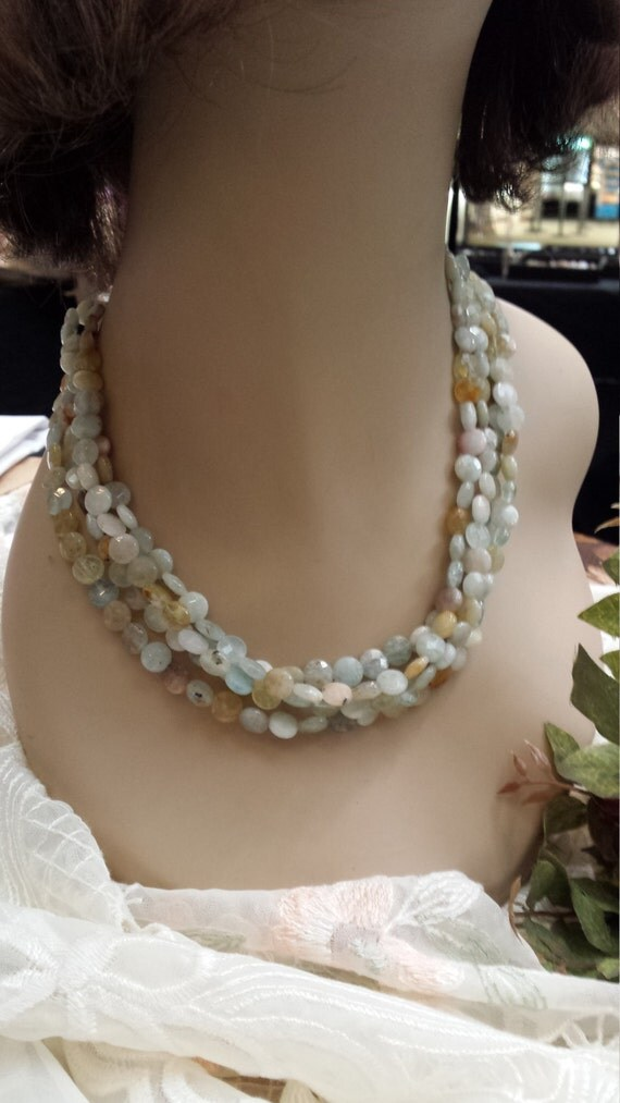 four strand faceted sea green beaded necklace