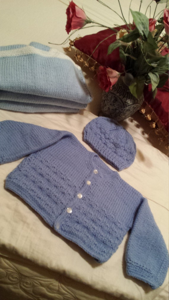 Hand knitted baby sweaters sets made by aunt Corry