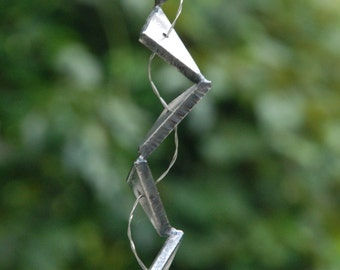 Abstract metal sculpture, small triangular abstract sculpture
