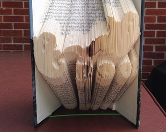 Book folding art pattern for Halloween Ghosts with the word BOO !