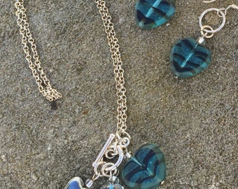 Glass heart pendant on sterling silver chain