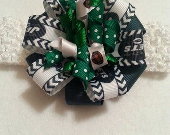 Jets double stacked bow with a korker bow with a white headband