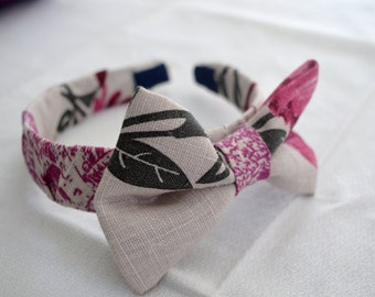 Headband covered in linen with decorative bow