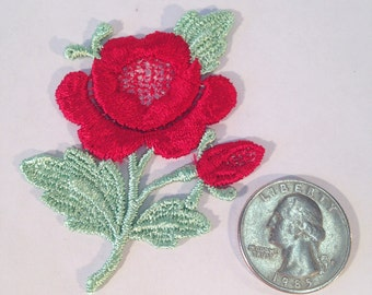 Red rose with green leaves sew-on rayon appliqué, approx. 3 inches high and 2 inches wide. 105 pieces.