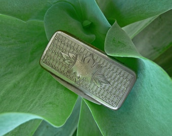 Nice all brass , silver plated snuff box .