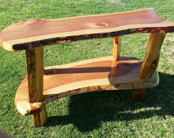 Coffee table or end table. Can be used as a TV Stand. Handmade live-edged Juniper.    Very smooth and durable finish.