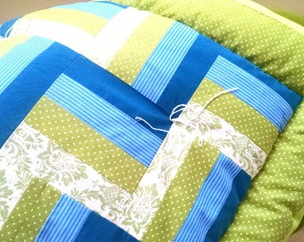 The COZIEST, easy-to-make over-stuffed, tied baby quilts