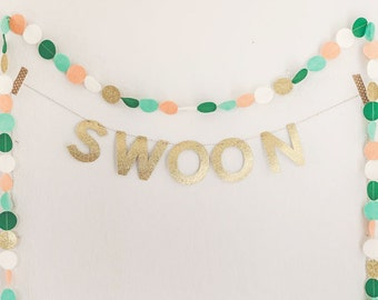 Custom glitter word garland and felt circle garland in ivory, peach, green, and gold.  Custom name garland. Word banner. Name banner.