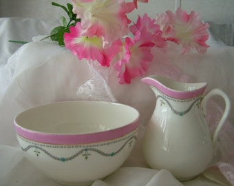 Small pottery milk jug creamer and slop or sugar bowl pink white