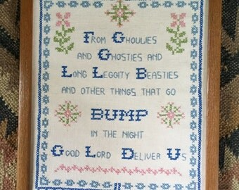 Needlepoint embroidered wall hanging quote