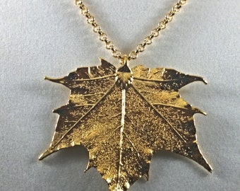 Beautiful hand-crafted 24-carat gold pendant maple leaf