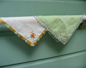 Pair of embroidered cotton handkierchiefs with crocheted edging.