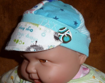 Infant Jax Hat in blues with ooga booga monster fabric for infant 0-6 months
