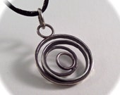 Many Rings Handmade Sterling Pendant on a Black Satin Cord